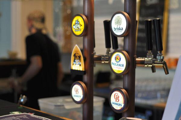 Bild på öltappar av olika märken